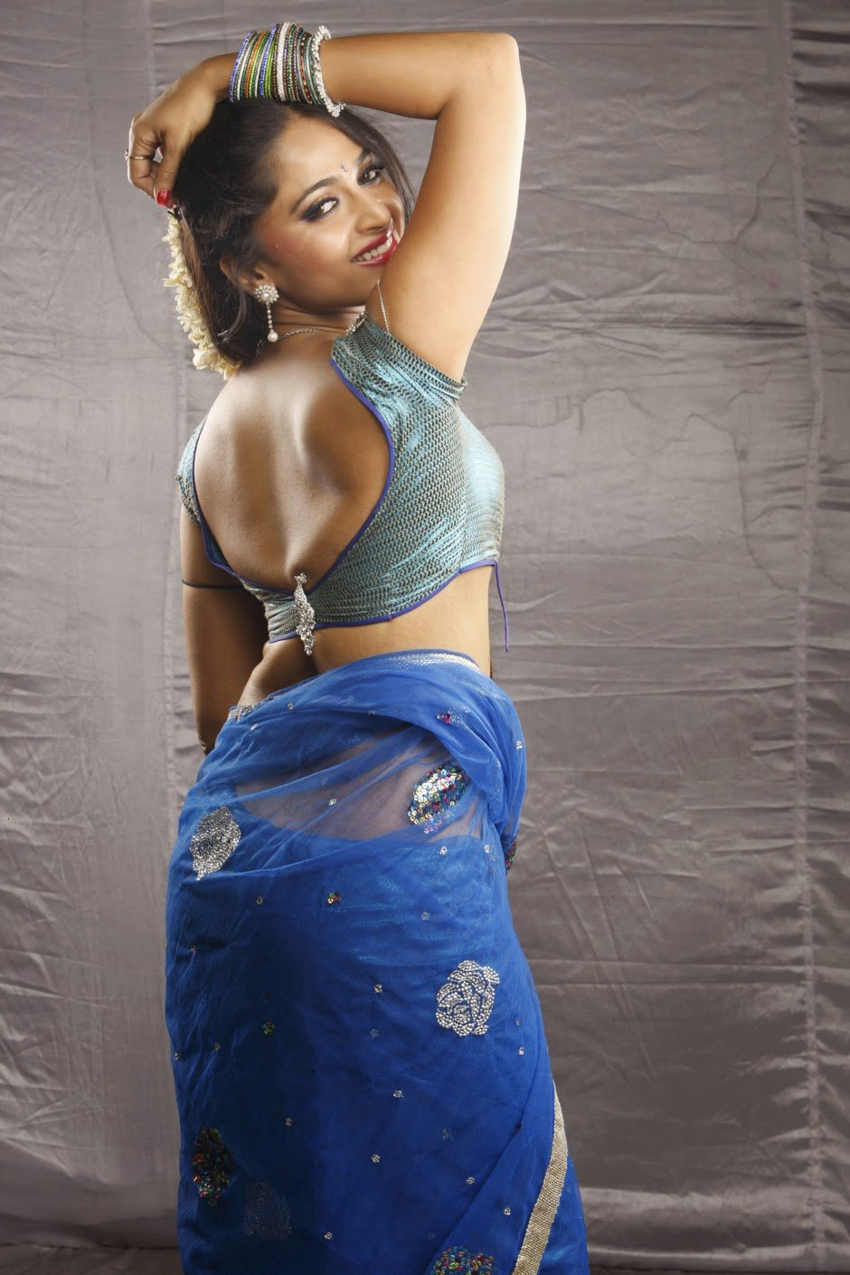 Anushka Shetty Hot In Backless Blouse Photos and Navel Show HD Stills